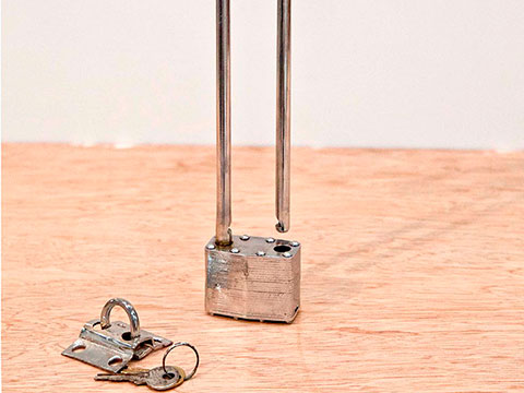 Faith, 2013 / Nickel plated metal and padlock / 31 x 22 x 3 cm